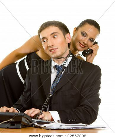 Young Businessman With Telephone Wire Around His Neck On A Computer And A Young Business Woman With
