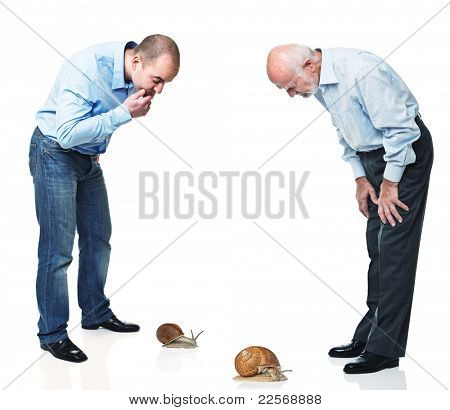 two man look at snail race