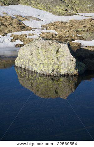 Rock Mountain On Water