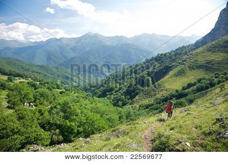 Trekking Woman Down Valley In Picos De Europa