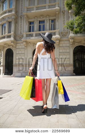 White Dressed Woman With Hat And Shopping Bags