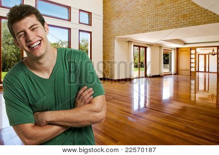 Young successful man at his brand new big house
