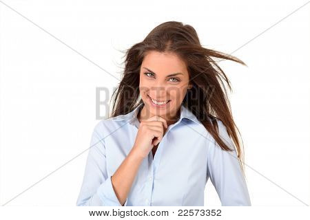 Portrait of beautiful woman with hand on chin