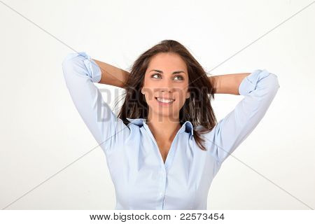 Beautiful relaxed woman with arms behind head