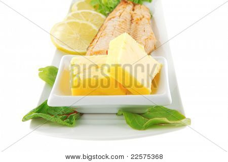 big grilled salmon steak over white plate