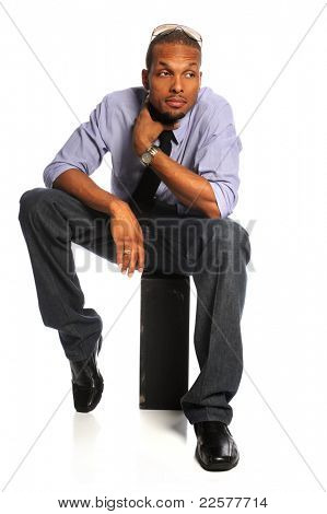 Young African American businessman sitting isolated over white background