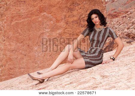 Pretty brunette woman in sexy dress