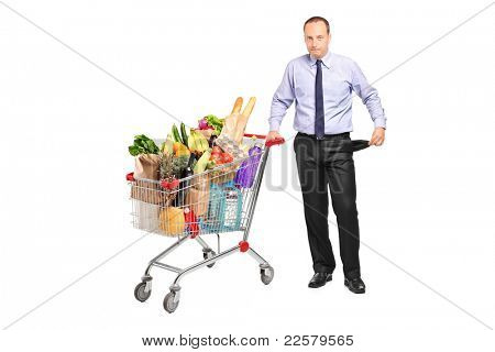 Bankrupt man holding a shopping cart and gesturing no more money isolated on white background