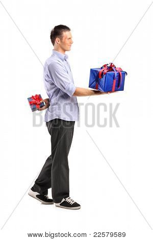 Full length portrait of a male giving a large gift and hiding a small one isolated on white background
