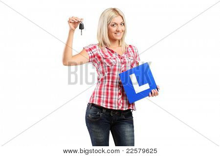 Happy teenager holding a car key and L plate isolated on white background
