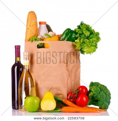paper bag with vegetables and food isolated on white