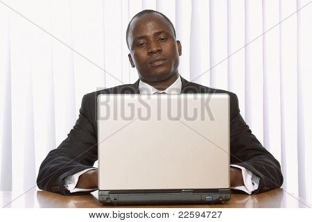 african amercian businees man working on his laptop