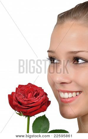 Young woman is pleased with red rose