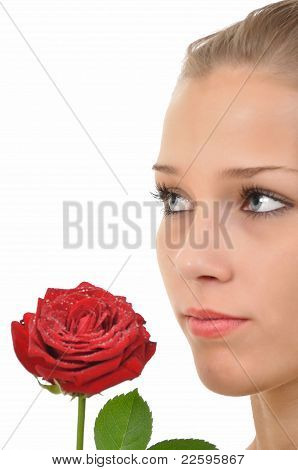 Serious young woman with red rose
