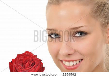 Face and red rose with water drops