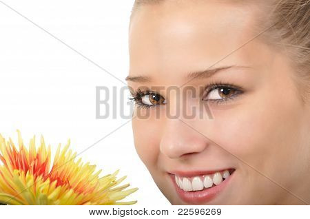 Young woman with brown eyes and flower