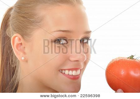 Young woman holding a red tomato