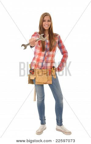 Craftswoman holding up large wrench