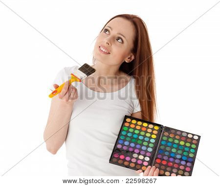 Young Woman With Cosmetic Palette And Paintbrush.