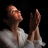 pic of piety  - Woman with hands folded in prayer looking up toward the Light - JPG