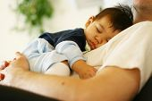 stock photo of sleeping baby  - Father napping with baby asleep on his chest - JPG