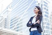 Young Beautiful Business Woman Standing In City With Success Feeling For Work. Young Business Woman poster