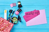 Beautiful Make Up Cosmetics Composition. Gift Bag And Cosmetics, Blue Wooden Background. Pink Card W poster