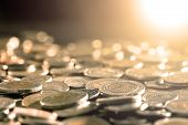 Close Up Money Coin On The Floor In Dark Light , Business And Financial For Money Saving Or Investme poster