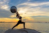 Silhouette  Healthy Woman Lifestyle Exercising Vital Meditate And Practicing Yoga And Gym Ball On Th poster