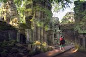 Постер, плакат: Traveler Take A Photo Ta Prohm Temple Or Tom Rider Temple Is On Angkor Wat Temple Area In Siem Rea