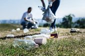 Environmental Pollution. Selective Focus Of Litter Lying On The Grass In The Park poster