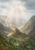 Mysterious Sunrays Shining On Mountain Peaks In Xo-xo Valley Of Santa Antao Island In Cape Verde. poster