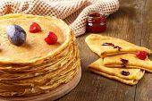 A Pile Of Thin Hot Pancakes With Fruits Of Strawberries And Plums, A Few Pancakes With Jar Of Jam On poster