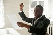 Excited Happy Black Businessman Enjoying Good News About Promotion In Written Notice, African Americ poster