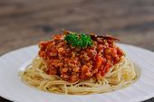 Spaghetti Bolognese Sauce With Beef Or Pork,cheese,tomatoes And Spices On White Plate. Delicious Bol poster