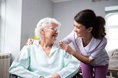 Satisfied And Happy Senior Woman Patient With Nurse poster