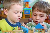 stock photo of children group  - the children in kindergarten plays with enthusiasm - JPG