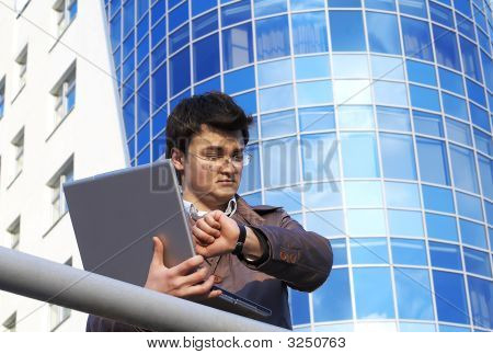Young Businessman Checking His Time