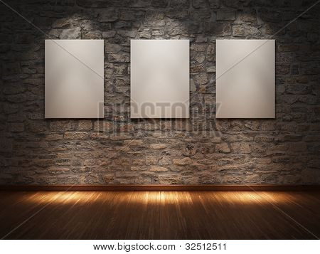 Blank frame on stone wall illuminated spotlights