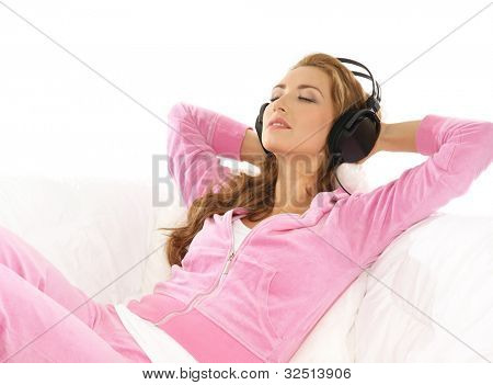 Young attractive girl listening to the music in modern interior