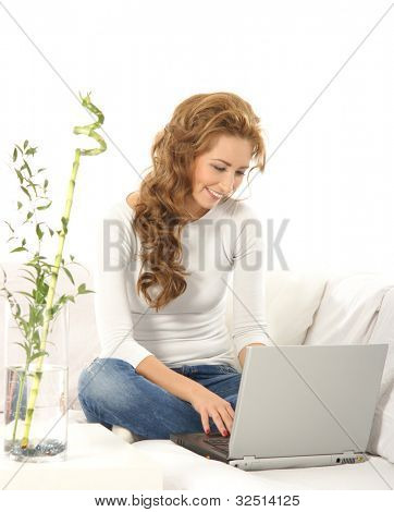 Young girl with a pc in a modern interior