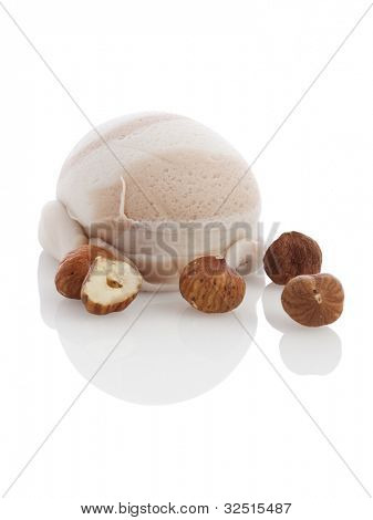 ice cream ball with hazelnuts isolated on white background