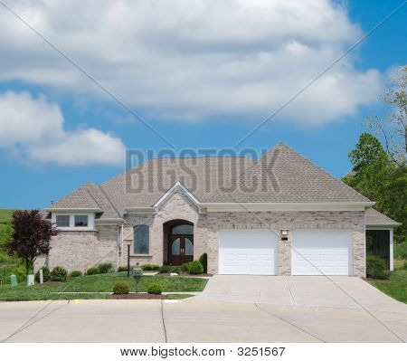 Light Tan Brick Suburban Home