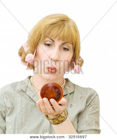 Blonde Woman With Hair Curlers Looking Into Mirror