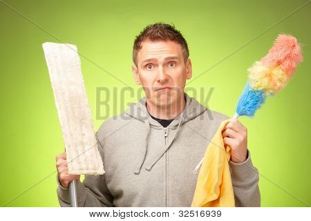 Man unhappy, confused and unsure being not prepared to clean a house