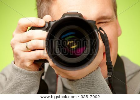 Male photographer taking photos with DSLR digital camera