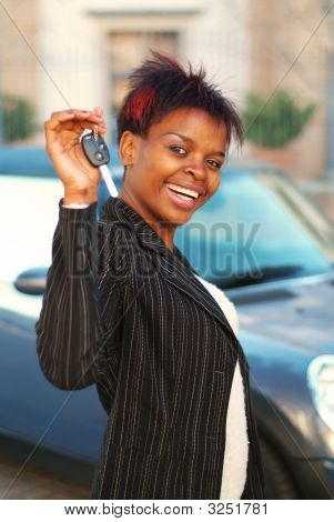 Smiling Happy Business Woman With Keys To New Car