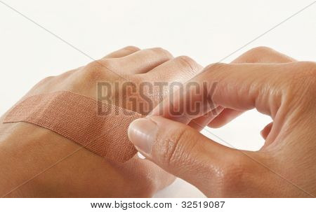 Two Hands With Bandage