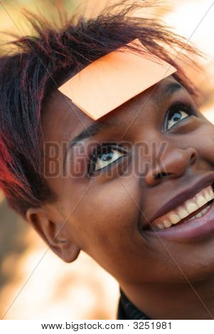 African American Woman With Sticky Note