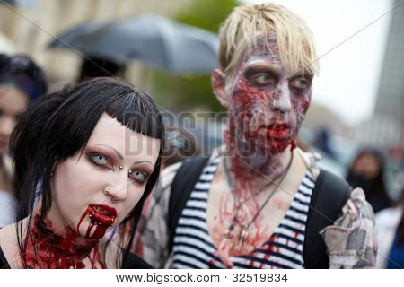 MOSCOW - MAY 14: A pair of unidentified young vampires with face piercing in Zombie Parade on Old Arbat, May 14, 2011, Moscow, Russia.
